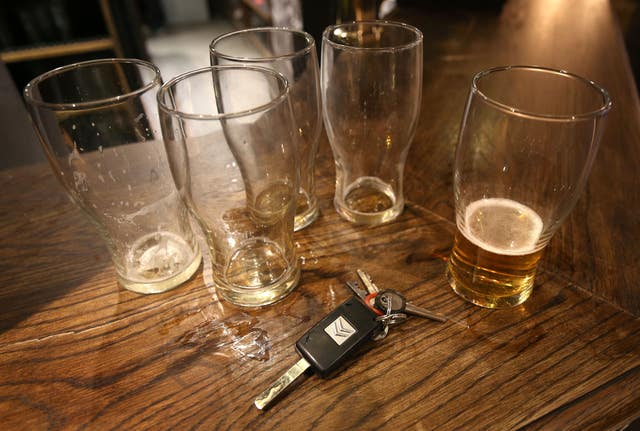 Beer glasses and a set of car keys on a bar in a pub in central London (Philip Toscano/PA)