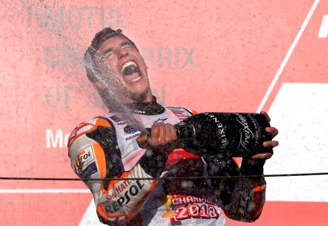 Marc Marquez celebrates winning a fifth MotoGP world title