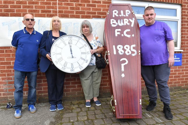 Bury fans deliver a symbolic coffin at Gigg Lane