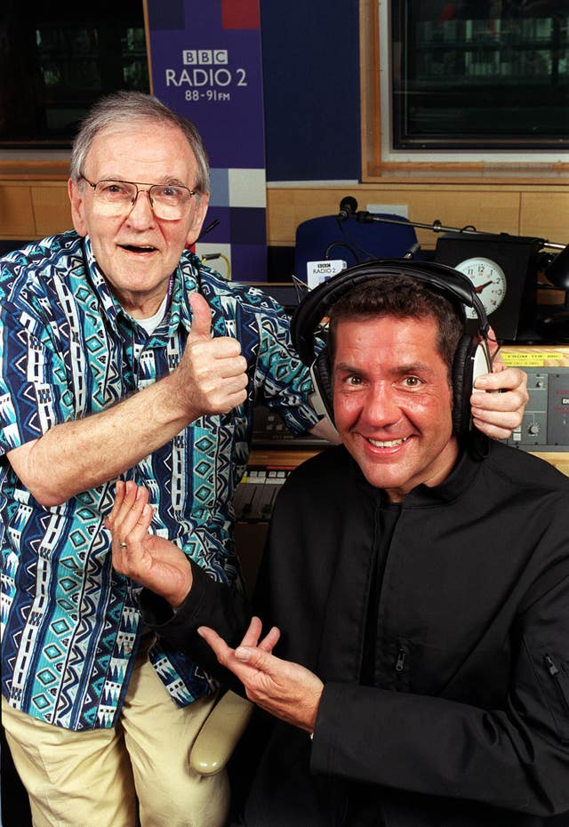 With Alan 'Fluff' Freeman as the veteran DJ handed over the reins of his BBC Radio 2 show Pick of the Pops to Winton in 2000 (Jeff Overs/BBC)