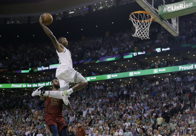 Boston Celtics guard Terry Rozier soars toward the basket past Cleveland Cavaliers forward LeBron James (Charles Krupa/AP)