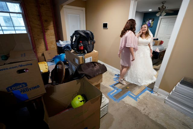 Nicole Caswell talks to her daughter Emily Pascale before her wedding, inside the home of Emily's now in-laws in Grand Lake, Louisiana