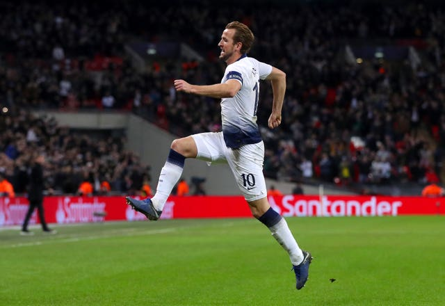 Two goals in the last 12 minutes from Harry Kane kept Spurs in the Champions League