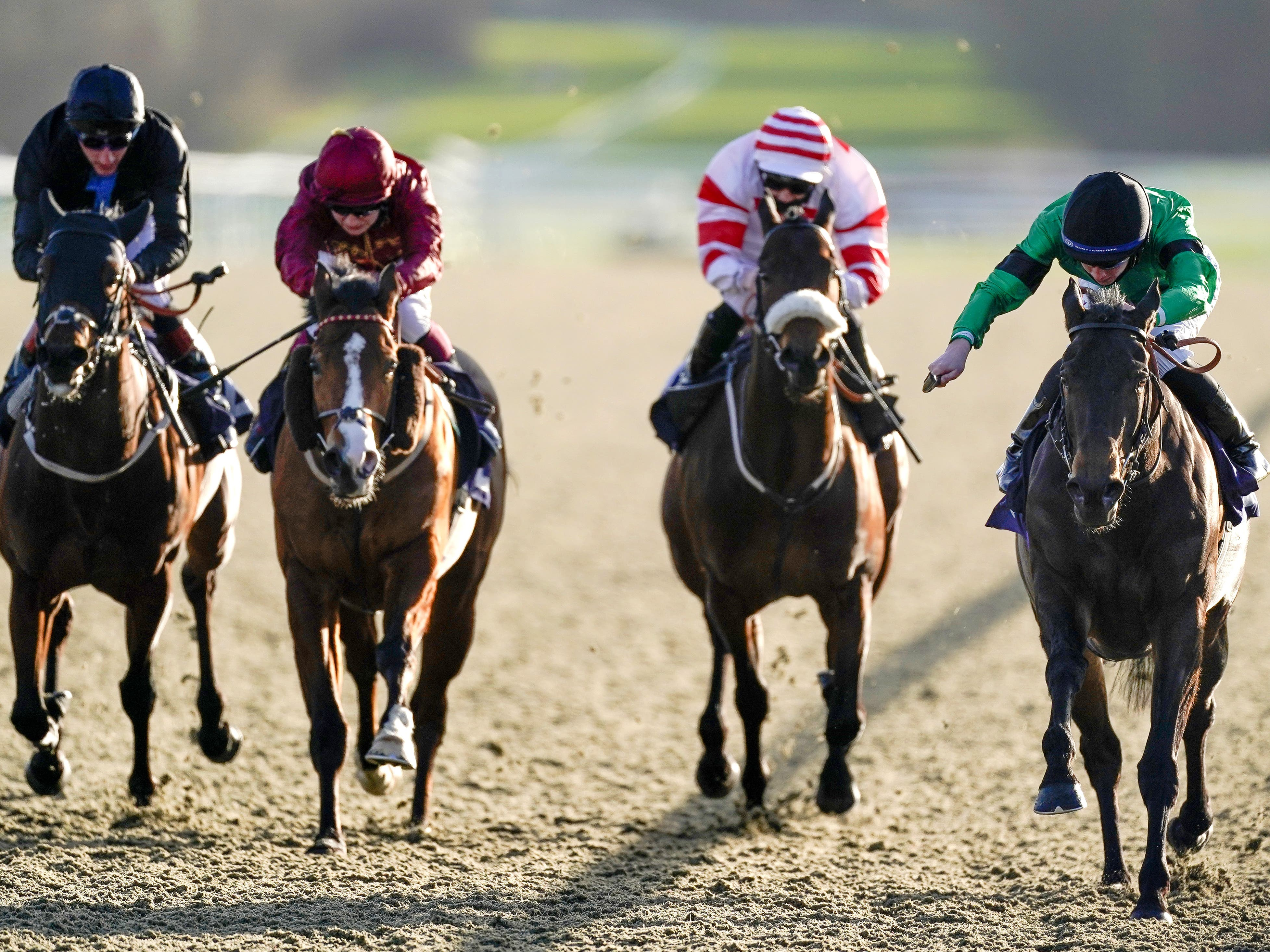 Fizzy Feet (right) on her way to victory at Lingfield (Alan Crowhurst/PA)