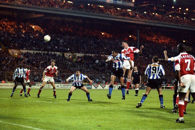 Andy Linighan heads Arsenal's extra-time winner against Sheffield Wednesday in 1993. It was the last time the FA Cup final was decided in a replay