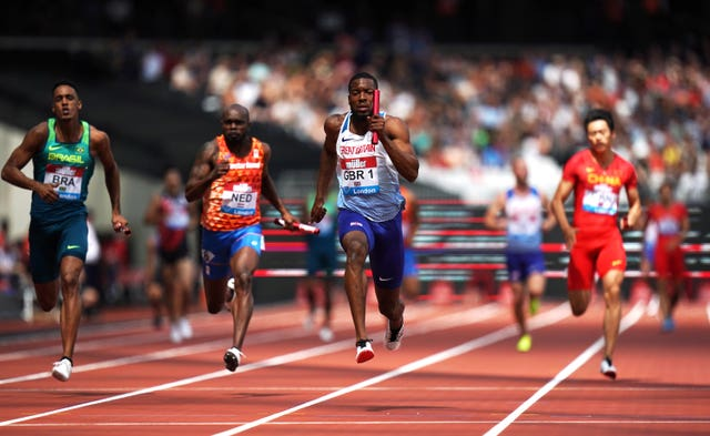 Great Britain's Nethaneel Mitchell-Blake (centre) on the way to winning the men's 4x100m relay