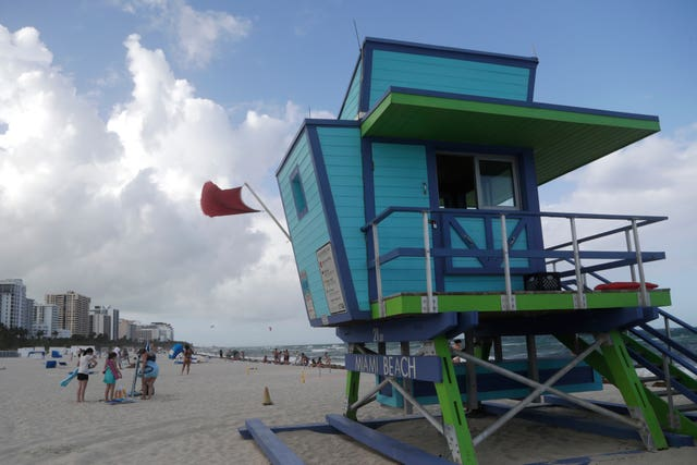 A red flag flies from a lifeguard station indicating high surf, in Miami Beach, Florida (Lynne Sladky/AP)