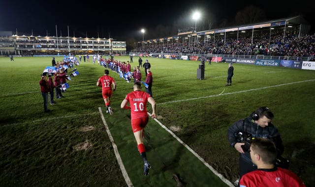 Owen Farrell, foreground, takes to the field with Saracens