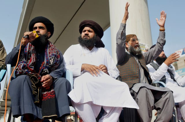 Local leaders of Tehreek-e-Labiak Pakistan, a radical Islamist political party, attend a protest against the arrest of their party leader, Saad Rizvi, in Lahore, Pakistan (K. M. Chaudary/AP)