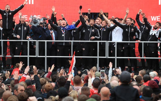 Sheffield United players and manager Chris Wilder on stage during the promotion parade