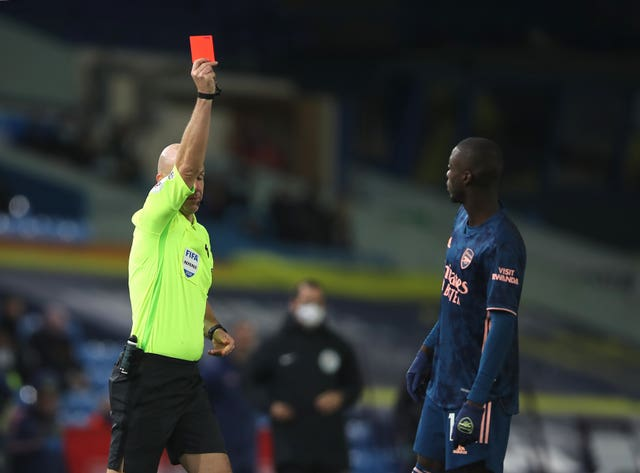 Nicolas Pepe, right, was sent off at Elland Road (Molly Darlington/PA)