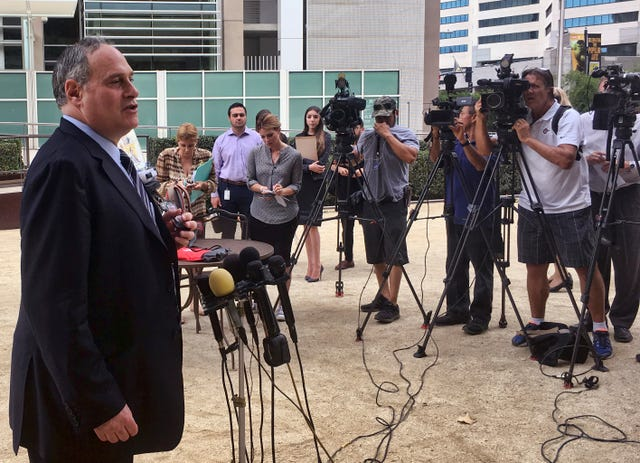 ACLU lawyer Lee Gelernt addresses reporters after a hearing in San Diego