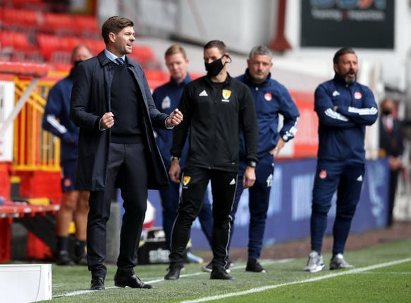 Rangers manager Steven Gerrard (left) saw his side kick off with a win