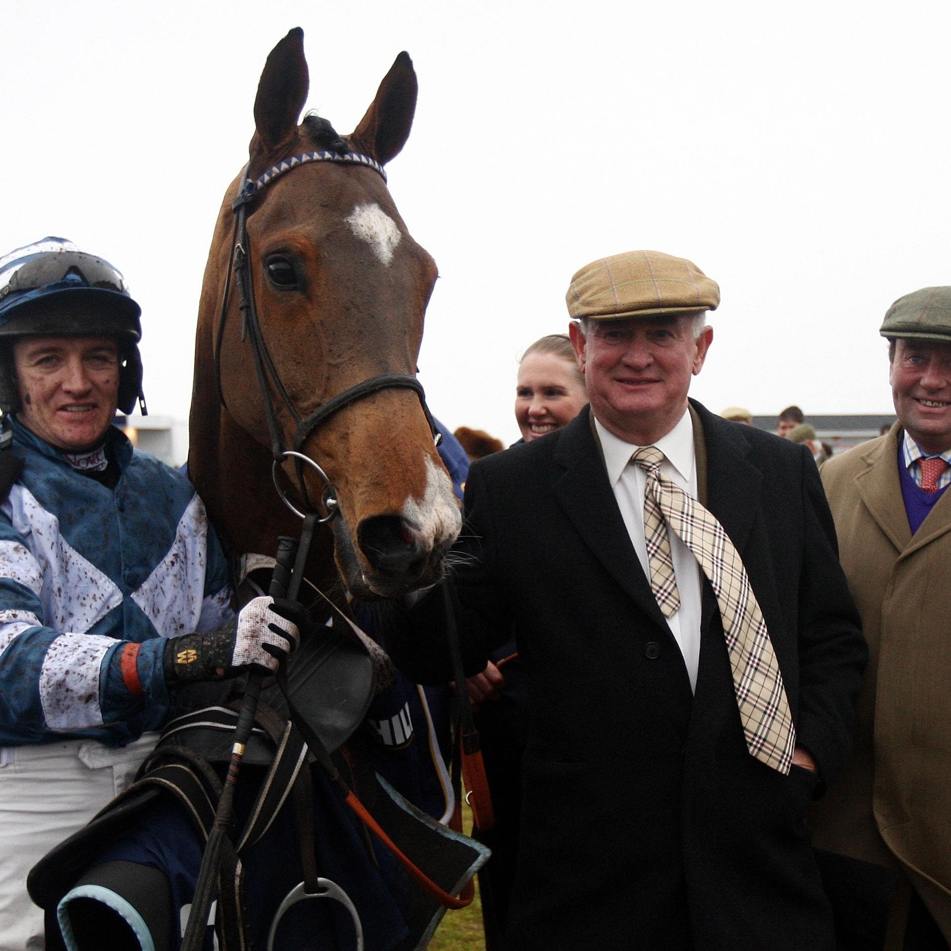 Dai Walters (second right) believes racing should resume