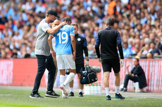 Leroy Sane, centre, limped off at Wembley
