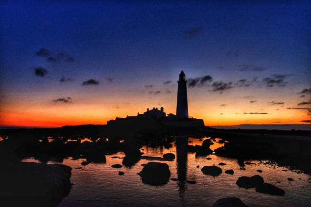 The sunrise over St Mary's lighthouse at Whitley Bay