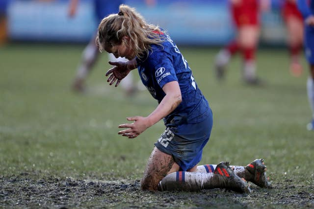Chelsea's Erin Cuthbert kneels in the mud during the Women's Super League draw with Liverpool