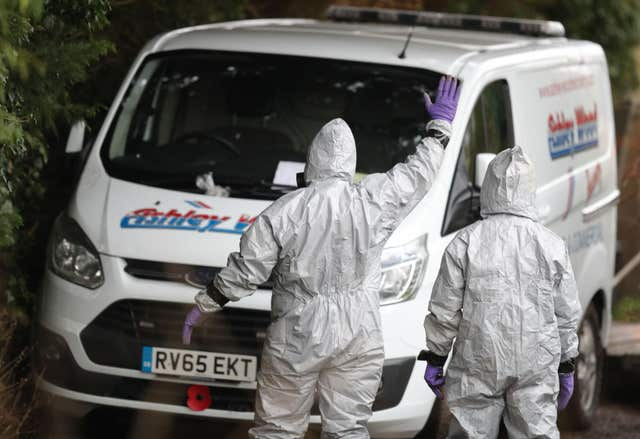 Investigators in protective clothing remove a van from an address in Winterslow (Andrew Matthews/PA)