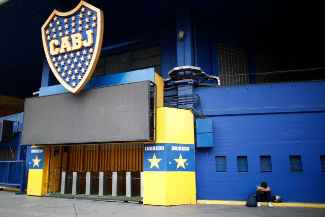 A football fan mourns Diego Maradona outside La Bombomera, home of Boca Juniors