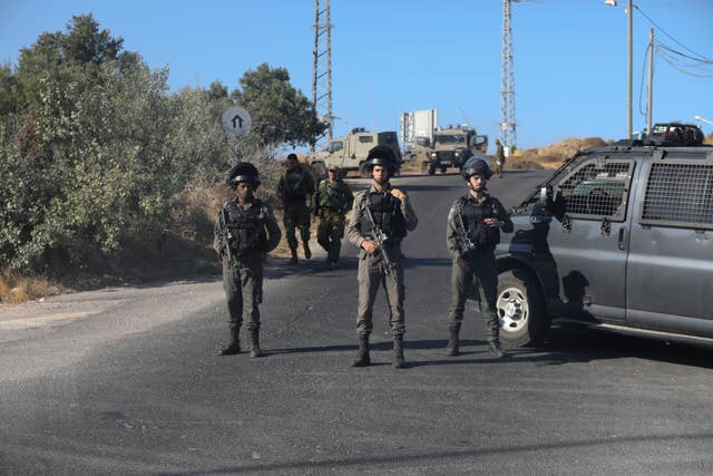 Israeli troops secure the area