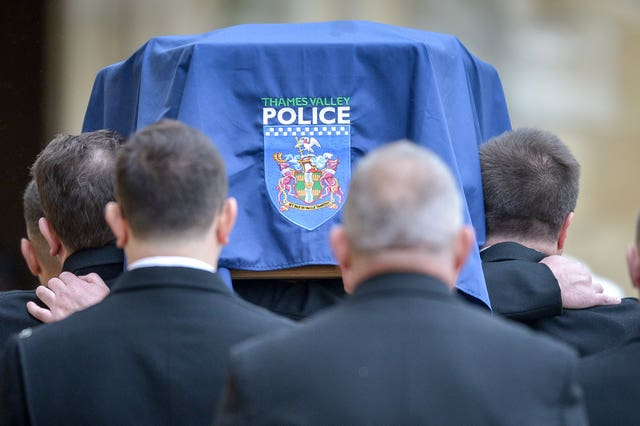 The police insignia on the coffin at the funeral of Pc Andrew Harper (Ben Birchall/PA)