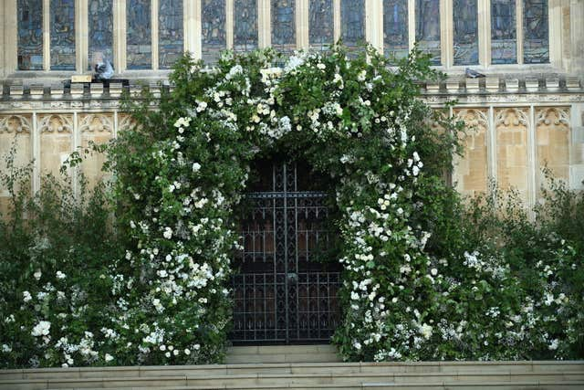 Flowers and foliage surrounded the West Door of St George's Chapel at Windsor Castle (Danny Lawson/PA)