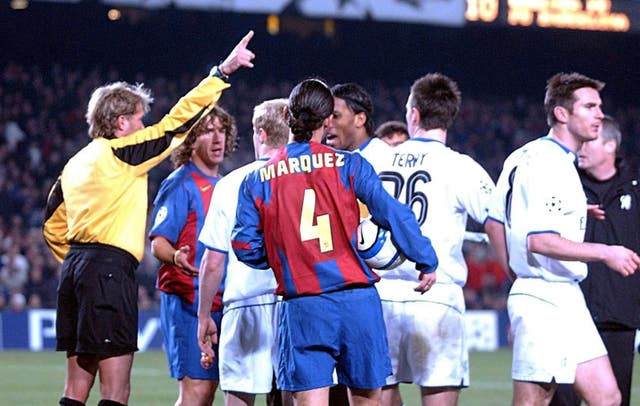 Referee Anders Frisk (far left) in charge of the Barcelona versus Chelsea match. (PA)