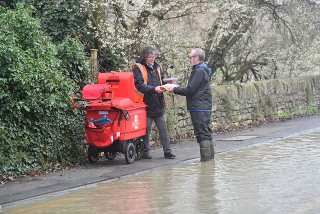 Man helps postman deliver through floods