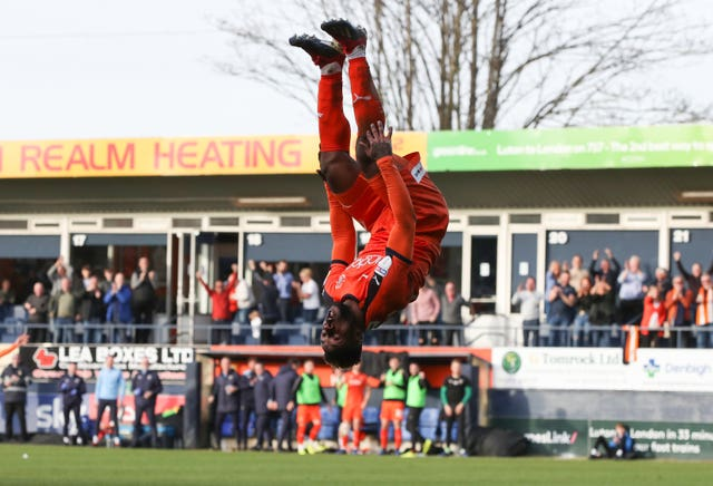 Kazenga LuaLua celebrated Luton's third goal in style as they beat Doncaster to make it 26 league games unbeaten