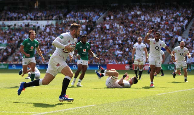 Elliot Daly runs in one of England's eight tries in their rout of Ireland at Twickenham