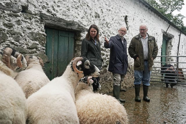 Labour leader Jeremy Corbyn and shadow Defra secretary Sue Hayman during a visit to Rakefoot Farm in Castlerigg