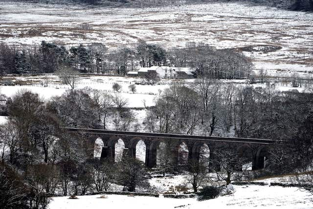 Griseburn Viaduct covered in snow in the Lake District as bad weather led to travel disruption (Owen Humphreys/PA)