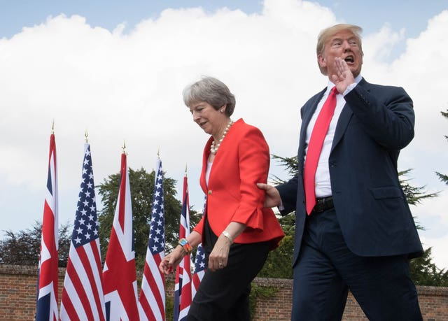 US President Donald Trump walking with Prime Minister Theresa May prior to a joint press conference at Chequers, her country residence in Buckinghamshire