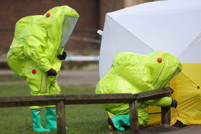 Personnel in hazmat suits have been examining sites in Salisbury following the nerve agent attack (Andrew Matthews/PA)