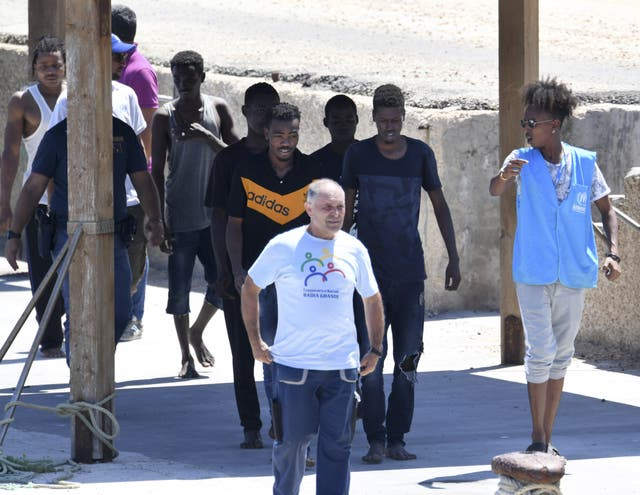 Migrants who jumped off the Open Arms arrive on Lampedusa