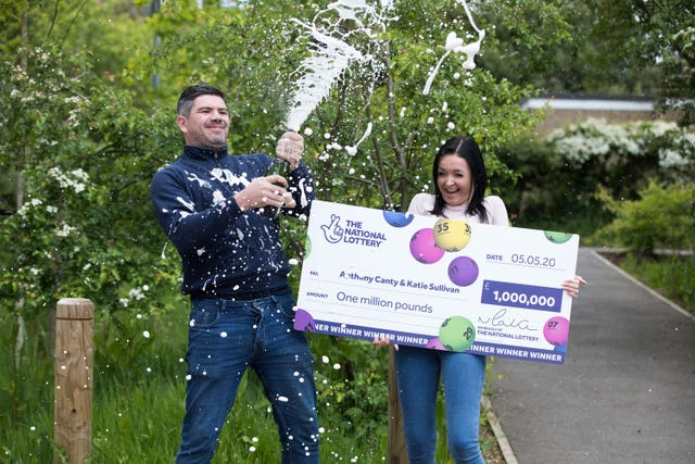 Handout photo dated 13/05/20 issued by the National Lottery of Anthony Canty, 33, from Maldon in Essex, who won �1 million in the Euromillions UK Millionaire Maker draw on May 5 celebrating with his partner Katie Sullivan