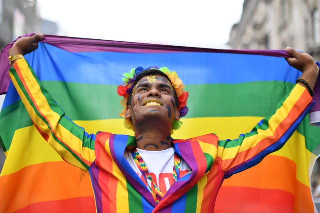 A reveller ahead of the Pride in London Parade