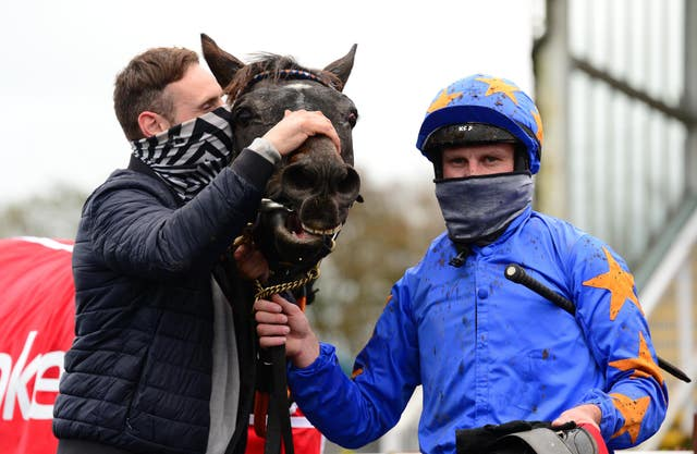 Ronan McNally (left) and Paul Townend with The Jam Man after winning the Troytown