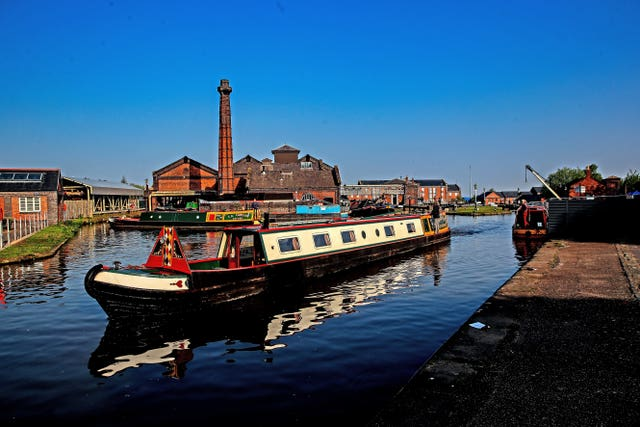 A canal boat leaves the Ellesmere Port Boat Museum after the Easter Boat Gathering