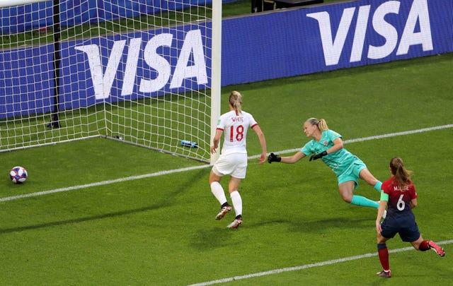 Ellen White, left, taps in England's second goal