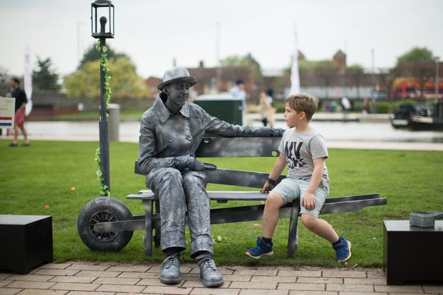 A young boy watches Dutch performer Ye Olde Bench  (Aaron Chown/PA)