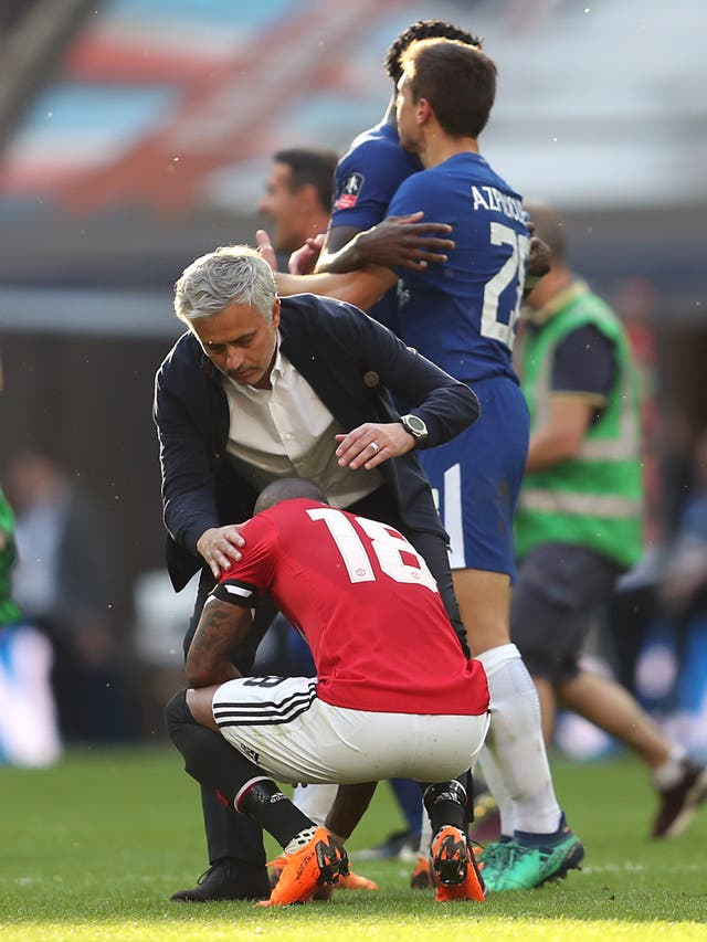Mourinho consoles Ashley Young after United lost the 2018 FA Cup final to former club Chelsea