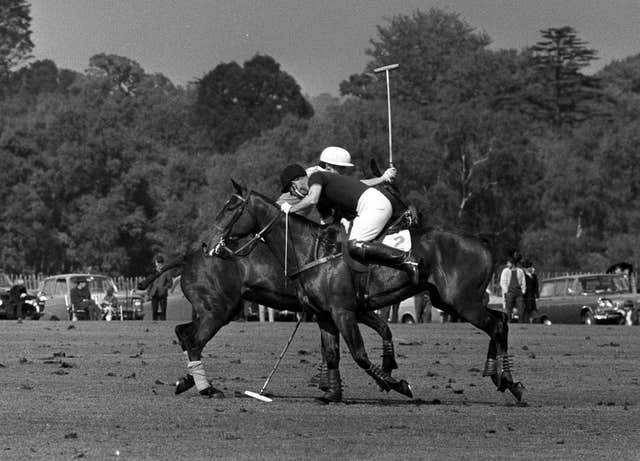 The Duke of Edinburgh in action during a polo match at Smith's Lawn in Windsor Great Park (PA)