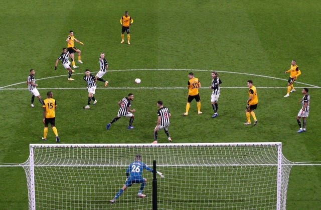 Raul Jimenez, top left, fires Wolves ahead