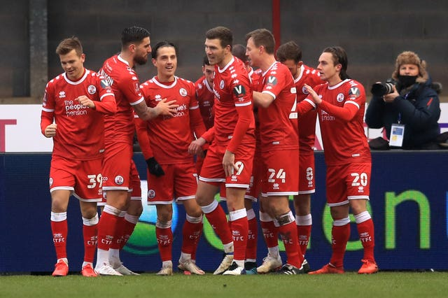 Crawley celebrate scoring their second goal against Premier League Leeds