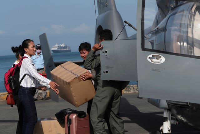 Cambodian medical officers unload equipment