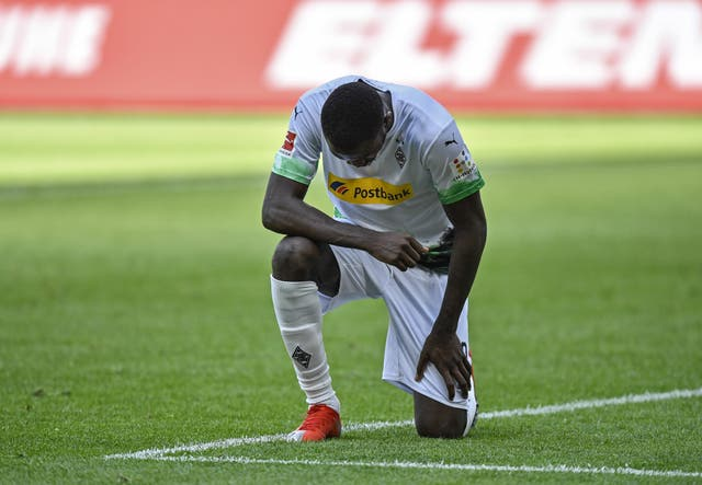 Marcus Thuram takes the knee after scoring for Borussia Monchengladbach at the weekend