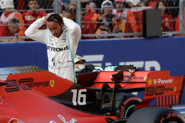 Lewis Hamilton split the two Ferraris