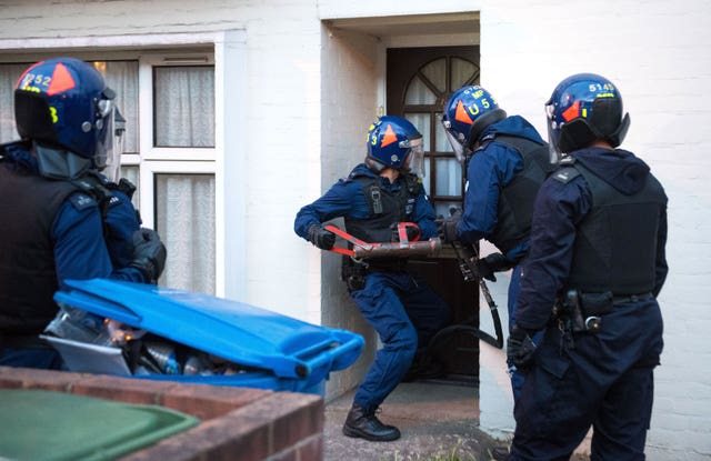 Police officers carrying out a raid